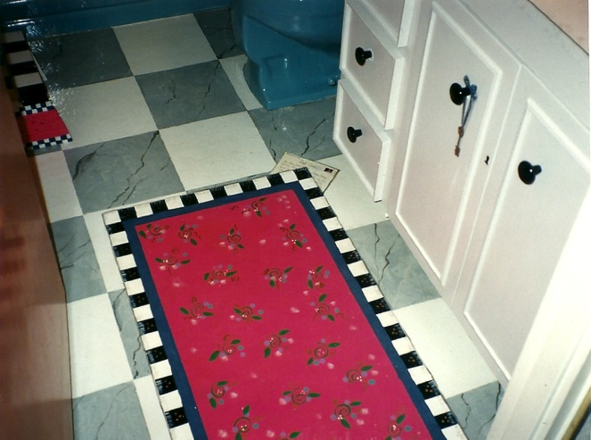 This entire floor was painted - faux tile, faux rug, faux postcard (real stamp), faux key and key hole